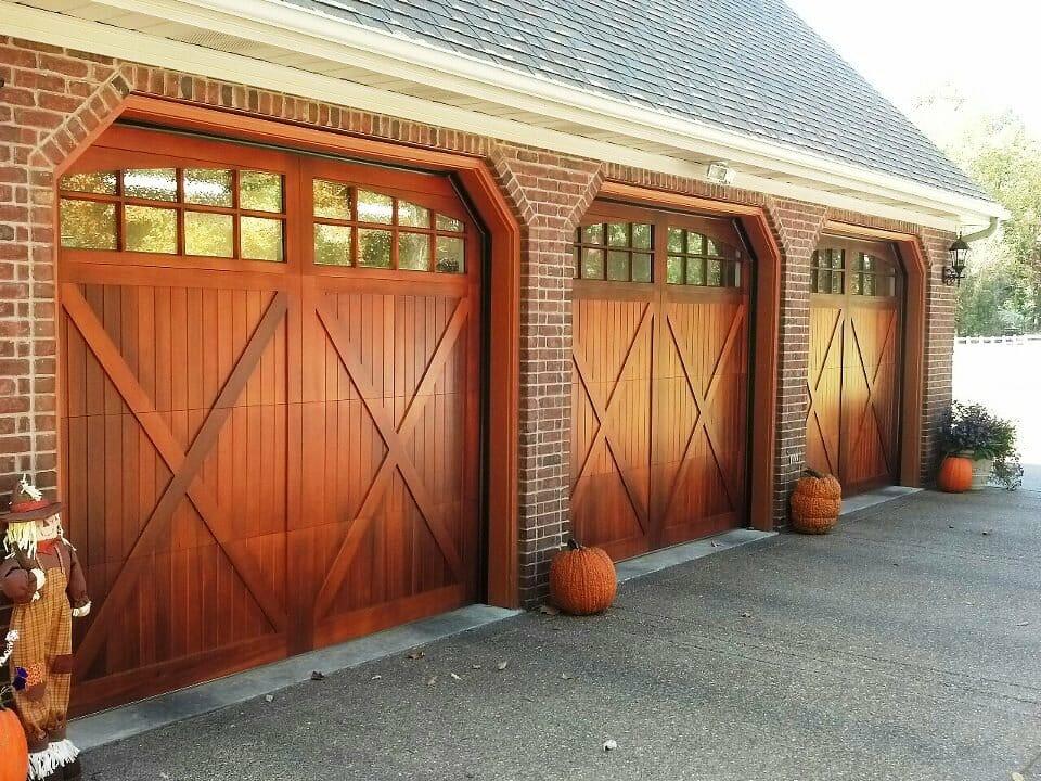 Carriage door at smart doors your carriage house overlay expert - Wooden garage door designs ...